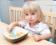 Toddler Feeding Herself Stock Image