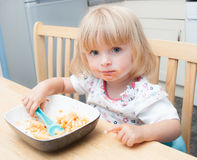 Toddler feeding herself Stock Image