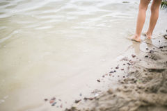 Toddler feet in water at the beach Royalty Free Stock Photos