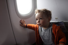 Toddler on the flight. Toddler is on the flight at an airplane Stock Images