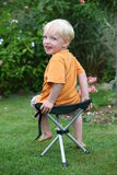 Toddler on a folding chair Royalty Free Stock Photo