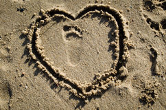 Toddler Footprint and Heart in Sand Royalty Free Stock Image