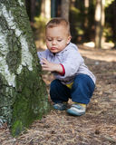 Toddler in forest Stock Images