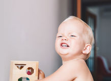 Toddler frowns and expresses disagreement on his face. Cute toddler frowns and expresses disagreement on his face. Adorable baby boy makes a funny serious royalty free stock photo