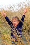 Toddler fun in beach grass Royalty Free Stock Photos