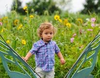 Toddler in Garden Stock Photo