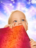 Toddler with a gift box Stock Images