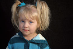 Toddler Girl. A toddler girl in turquoise stripes shyly smiling Royalty Free Stock Images