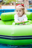 Toddler girl  in the amusement park Royalty Free Stock Images