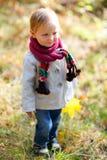 Toddler girl at autumn park Royalty Free Stock Photos