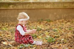 Toddler girl on the autumn park Royalty Free Stock Photography