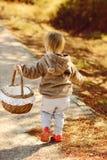 Toddler girl  with basket Stock Photos