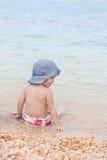 Toddler girl in a bathing Stock Photos