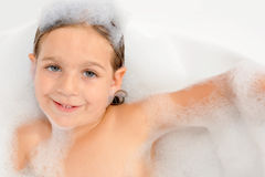 Toddler girl in bathtub Royalty Free Stock Images