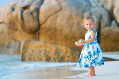 Toddler girl on the beach Royalty Free Stock Photos