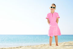 Toddler girl on the beach Stock Image