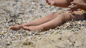 Toddler girl on beach. stock video