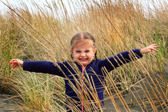 Toddler girl in beach grass Stock Images