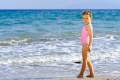 Toddler girl at beach Stock Image