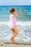 Toddler girl at beach Stock Photo
