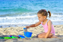 Toddler girl at beach Stock Photo