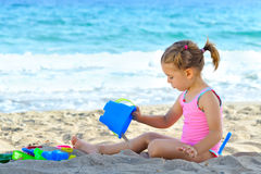 Toddler girl at beach Royalty Free Stock Photos