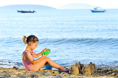 Toddler girl at beach Stock Images