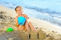 Toddler girl at beach Stock Photos
