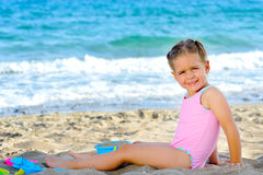 Toddler girl at beach Stock Photos