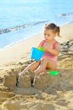 Toddler girl at beach Stock Image