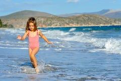 Toddler girl at beach Royalty Free Stock Photos