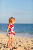 Toddler girl on beach at sunset Royalty Free Stock Photography