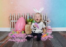 Toddler girl being silly at easter Stock Photos