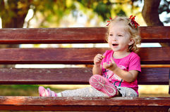 Toddler girl on the bench Royalty Free Stock Photography