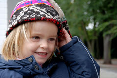 Toddler girl with big cap. Little girl wears a  big bolivian man`s cap Stock Photography