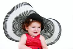 Toddler girl in big hat Stock Images