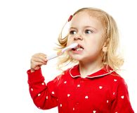 Toddler girl brushing her teeth Royalty Free Stock Photography