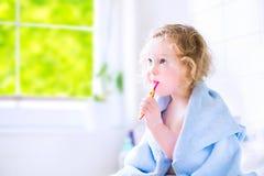 Toddler girl brushing teeth Royalty Free Stock Image