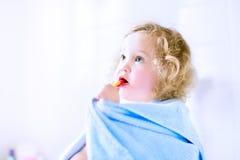 Toddler girl brushing teeth Royalty Free Stock Photos
