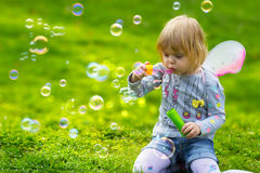 Toddler girl with butterfly wings having fun in park Stock Photography