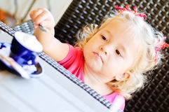 Toddler girl in cafe Stock Images