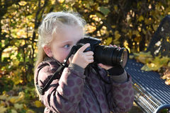Toddler girl with camera Stock Photos
