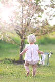 Toddler Girl Carrying Watering Can to Garden Royalty Free Stock Images