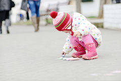 Toddler girl with chalk Stock Photo