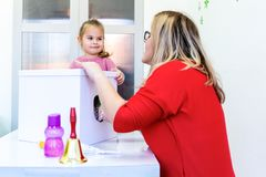 Toddler girl in child occupational therapy session doing sensory playful exercises with her therapist. royalty free stock images