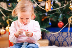 Toddler girl with Christmas candy Royalty Free Stock Images