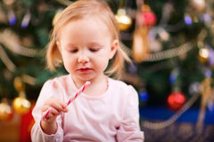 Toddler girl with Christmas candy Royalty Free Stock Image