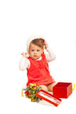 Toddler girl with Christmas gift Royalty Free Stock Photo