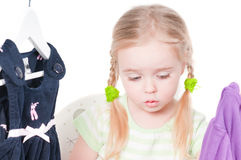 Toddler girl and clothes. Shot of cute toddler girl choosing clothes royalty free stock photography