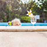 Toddler girl with cocktail in tropical beach pool Royalty Free Stock Image